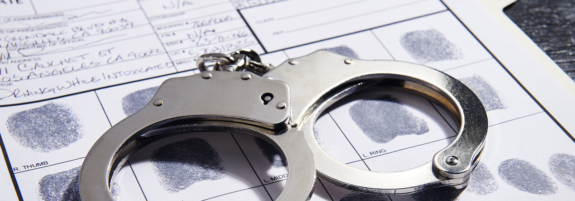 Handcuffs and background checks in San Jose, CA.